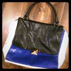 EUC LARGE Colorblock Trapeze Purse!! This bag is beautiful and spacious. Very clean. Black, white, and royal blue with croc texture. Inside pockets. Roughly 15in wide 11in tall. Cosmopolitan Bags