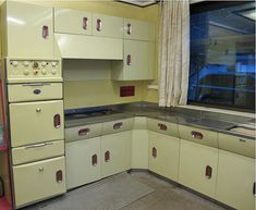1956 original vintage kitchen featuring vintage English Rose cabinets and REVO freestanding oven.