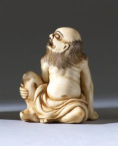 "IVORY FIGURE OF A SENNIN 19th Century In seated position. Signed ""Tomo"". Height 1.8"" (4.8 cm"