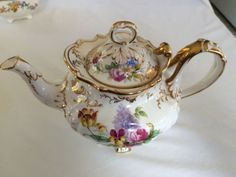 BROWN-WESTHEAD-MOORE Rococo Revival Teapot with Pansies