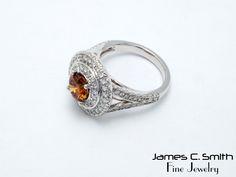Fancy orange diamond with white diamond accents in 14k white gold. #fancy #diamonds #orange