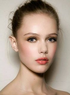 Beautiful peach cheeks and coral lips. via The Perfect Palette