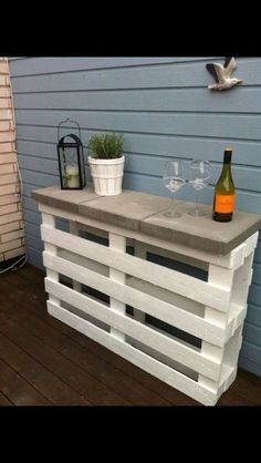 OUTDOOR SHELF-bar area. ONLY 2 pallets & 3 pavers! Paint white, secure inside with simple brackets, 3 pavers-can glue down w/ mortar from hardware store or industrial glue for pavers.