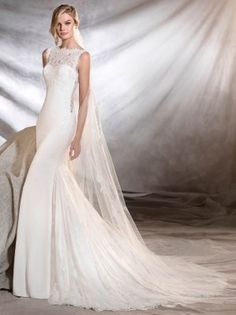 Unique and elegant fit and flare wedding dress with lace neckline by Pronovias- ORESTE