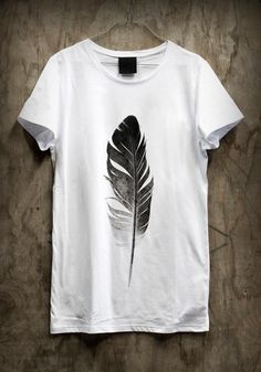 feather t-shirt, cute with a jean vest and black jeans.