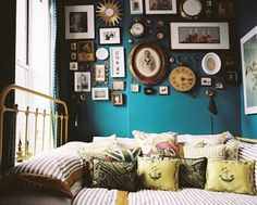I like the idea of a bold colored wall covered with lots of wall decorations (like I need more knick knacks all over my apt.) :)