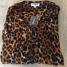 Express Porofino shirt The popular Portofino shirt in semi-sheer leopard print, button down with convertible sleeves. These shirts are adorable for work or date nights! NWT - small  ( I have sizes S & M) * price per shirt * Express Tops Blouses