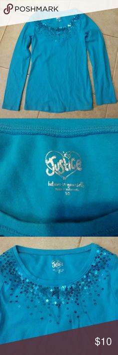 Justice. Sequin blue long sleeve shirt Pretty blue colored long sleeve cotton shirt with 95%cotton 5%spandex. Around the neckline in the front only are beautiful blue sequins. Excellent condition never worn.size 10 Justice Shirts & Tops