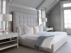 Love the large tufted headboard.