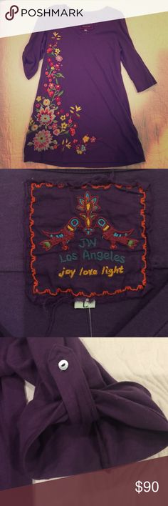 "NWOT Johnny Was Top NWOT Never Been Worn Purple Johnny Was V-Neck Top. 3/4 length sleeves with roll up.  Length from shoulder to hem is 31"". Shoulder to Shoulder is 14.5"" Johnny Was Tops Tees - Long Sleeve"