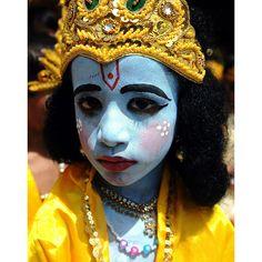 A child dressed as Lord Krishna to celebrate the birth of Lord Krishna. Mumbai