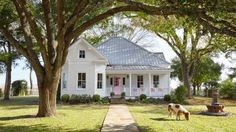 This 105-year old Victorian farmhouse in Texas squeezes four classic rocking chairs on its porch (the pink door and the Shetland pony aren't too shabby when it comes to curb appeal, either).