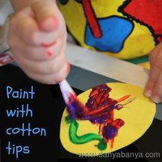 Paint paper Easter Eggs with cotton tips