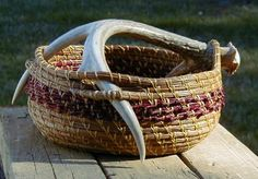 Pine needle basket with antler handle.       Gate.net