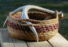Pine needle basket with antler handle.