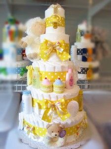 A custom 5 tier yellow diaper cake for a neutral baby shower from www.DiaperCakewalk.com