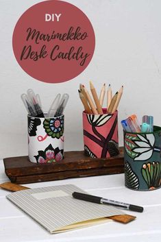 How to make a cool desk caddy out of Marimekko wallpaper samples.  Plus many more ideas for crafting with wallpaper samples and leftovers.  #wallpapercrafts #marimekko #deskcaddy