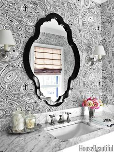 Lindsey Coral Harper papered the walls of a Charlotte, North Carolina, guest bathroom in a faux- stone pattern: Lee Jofa's Malachite. Sink fixtures by Waterworks. Mirror, Jonathan Adler.   - HouseBeautiful.com
