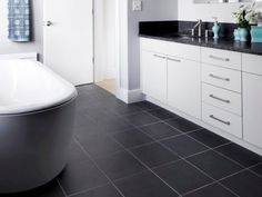 White Cabinets with Black Tile Floor