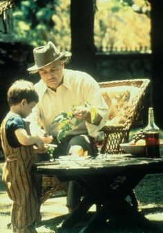 Famous Scenes From The Godfather (1972) - in the backyard, Don Vito feeding the tomatoes and playing with his grandson Anthony.