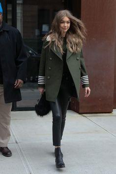 Gigi Hadid wearing Emm Kuo Majorelle Black Fox Bag, Tommy Hilfiger Gigi Green Coat, Freda Salvador Strong Boots and Frame Moto Leather Skinny Pants