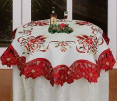 Christmas Embroidered Poinsettia Candle Bell Tablecloth  - Christmas Tablecloth, 34″ round, one piece; White material with embroidered poinsettias, candles, bells, ribbons … It also features a red border with poinsettia & bells outlined with gold embroidery and cutworks; Please check our other listings to order matching placemat, runner...  #Christmas #Christmas2013