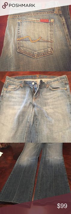 7 for all mankind jeans wide leg Style number u076055u-055u size 30. I am 5'4 and these are quite long on me. They are gently used and unaltered. I usually wear an 8 in suits and dresses these fit perfectly. Good for a boho or country look. 7 For All Mankind Jeans Flare & Wide Leg