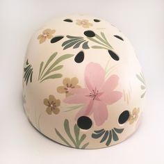 Springy, chic, and cheerful, this floral print is a perfect accent to anything you're wearing. This helmet is hand-painted with acrylics and ink in our studio. It's also coated with a UV-protected var