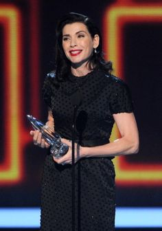 """Actress Julianna Margulies accepts the Favorite Network TV Drama award for """"The Good Wife"""" at the People's Choice Awards on Jan. 8, 2014."""