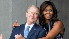 George W. Bush and Michelle Obama share hug on stage