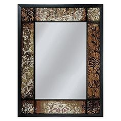 Deeply etched, bronze floral details surround the silk screened design of this Patchwork Mirror. This heirloom-quality accent features black box frame molding and exceptional style; its antiqued style elevates any room.