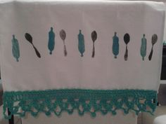 Kitchen towel decorated with self-made stamps and crochet