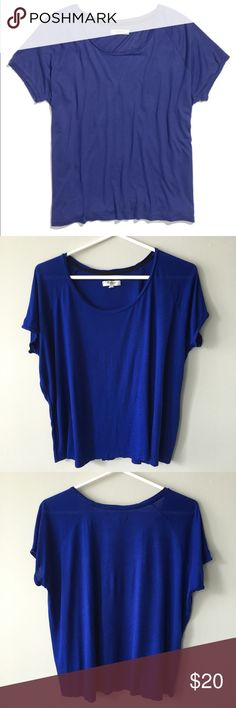 Madewell Swing Tee - Noble Blue Lightly worn Madewell Swing tee in vibrant, Noble Blue.   Our softest and most laid-back tee yet, with a perfect drape and subtle swing—in other words, it's effortlessly cool to the core. ·         Loose, wide fit. ·         Super soft Rayon. ·         Hand wash. ·         Item # 40171   No holes, stains or pilling. Sleeves curled a bit; can straighten out by ironing. Bundle & save 💰! Sorry - 🚫 trades! Madewell Tops Tees - Short Sleeve