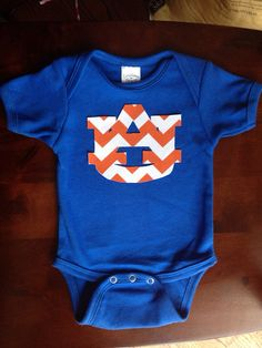 Blue one piece shirt with orange chevron Auburn football team symbol  on Etsy, $15.00