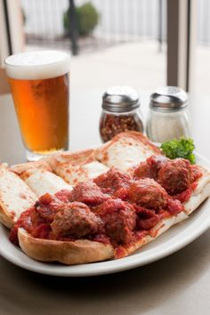 Meatball sub with melted mozzarella cheese and a cold beer....