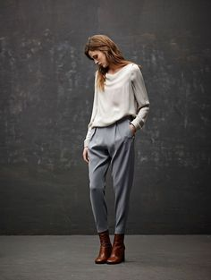 Blush loose fit long sleeve top, grey slacks, red leather boots