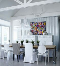 Love the white with a punch of color on the wall, especially love the industrial table on wheels.