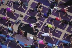 People practice yoga on the morning of the summer solstice in New York's Times Square June 20, 2012.   REUTERS-Shannon Stapleton