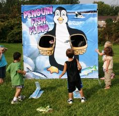 Penguin Fish Flinger Carnival Game - instead of throwing, kids step on board to launch.