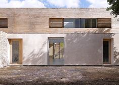 Lime render and horizontal spaced cladding + window treatment looks very stylish.   Orchard House by Studio Octopi