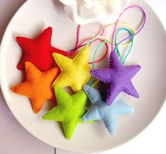Rainbow Stars Felt Christmas Ornaments Let us help you make your own christmas decorations at our . Felt Christmas Decorations, Rainbow Decorations, Felt Christmas Ornaments, Christmas Colors, Holiday Decor, Christmas Makes, Kids Christmas, Christmas Stars, Felt Crafts