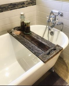 This is a handcrafted reclaimed wood Bath Caddy made by my carpenter extraordinaire dad and I! This tray is totally unique and one of a kind as it is made from old wooden pallets. I have one and absolutely love! This size makes the perfect bath caddy! Bathtub Caddy, Bathtub Tray, Bathroom Tray, Wood Bathroom, Diy Bathtub, Wooden Pallet Furniture, Wooden Pallets, Pallet Wood, Diy Wood