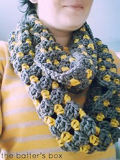 This free pattern is for a lightweight crochet striped infinity scarf that can be worn for warmth with your winter coat or alone as an accessory.