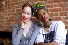 Diandra Forrest and Paola wearing Fanm Djanm headwraps out.