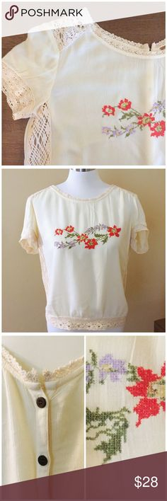 """Free People Floral Cross Stitch Lace Blouse - S Free People Floral Cross Stitch Lace Blouse --- size small --- 100% viscose --- cream blouse has lace trim, side panels, and shoulders --- vintage floral cross stitch design on bust --- button up back --- 21.5"""" bust --- 23"""" length --- 18"""" waist --- fabric does not provide stretch --- good preloved condition,  gently worn, no imperfections --- thank you for visiting my boutique, please feel free to ask any questions  Free People Tops"""