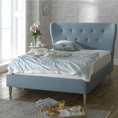 Retro looking bed frame with oak tapered feet and stylish duck egg blue upholstered fabric. Features a high padded headboard. Low foot end. Sizes: Double x King Size x or Super King x Manufactured by Limelight. Similar to Alam. Duck Egg Blue Fabric, Fabric King Size Bed, Super King Bed Frame, Buy Beds Online, Retro Bed, Superking Bed, Upholstered Bed Frame, Stylish Beds, Bed Furniture