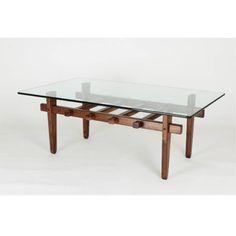 La mesa central de @artelier.mx  es contemporánea y elegante, con una superficie de vidrio y una estructura de madera delicadamente ensamblada. Disponible en @coferstudio . #architecture #interiordesign & #furniture