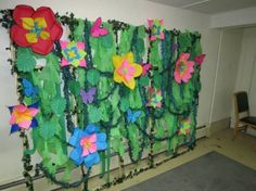 with ivy, green tablecloths cut to look like vines, streamers, curly . Green Tablecloth, Plastic Tablecloth, Tablecloths, Tablecloth Ideas, Paper Leaves, Paper Flowers, Vbs Crafts, Paper Crafts, Jungle Theme