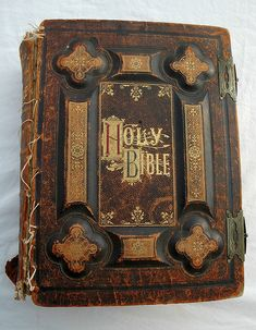 Holy Bible, dated 1885, antique gold lettering, leather and board, held together with dental floss.  120 year old Bible binding held together with dental floss, rusted metal clasps (120 years as of 2005). This bible was originally used in a Protestant church in Oklahoma, from a private family there. The page style is gothic.