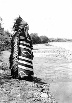 Tom Nash, Crow, on the edge of a river near Sheridan, Wyoming. 1900-1910. Photo by Louis R. Bostwick.